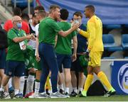 3 June 2021; Republic of Ireland manager Stephen Kenny and Republic of Ireland goalkeeper Gavin Bazunu embrace after the International friendly match between Andorra and Republic of Ireland at Estadi Nacional in Andorra. Photo by Stephen McCarthy/Sportsfile