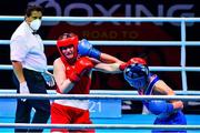4 June 2021; Aoife O'Rourke of Ireland, right, and Viktoryia Kebikava of Belarus in their middleweight 75kg round of 16 bout on day one of the Road to Tokyo European Boxing Olympic qualifying event at Le Grand Dome in Paris, France. Photo by Baptiste Fernandez/Sportsfile