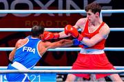 4 June 2021; Aidan Walsh of Ireland, right, and Wahid Hambli of France in their welterweight 69kg round of 16 bout on day one of the Road to Tokyo European Boxing Olympic qualifying event at Le Grand Dome in Paris, France. Photo by Baptiste Fernandez/Sportsfile