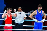 4 June 2021; Emmet Brennan of Ireland, left, is declared the winner over Uke Smajli of Switzerland after their light heavyweight 81kg round of 16 bout on day one of the Road to Tokyo European Boxing Olympic qualifying event at Le Grand Dome in Paris, France. Photo by Baptiste Fernandez/Sportsfile