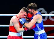 4 June 2021; Emmet Brennan of Ireland, left, and Uke Smajli of Switzerland in their light heavyweight 81kg round of 16 bout on day one of the Road to Tokyo European Boxing Olympic qualifying event at Le Grand Dome in Paris, France. Photo by Baptiste Fernandez/Sportsfile