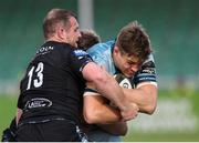 4 June 2021; Garry Ringrose of Leinster is tackled by Nick Grigg of Glasgow Warriors during the Guinness PRO14 Rainbow Cup match between Glasgow Warriors and Leinster at Scotstoun Stadium in Glasgow, Scotland. Photo by Ross MacDonald/Sportsfile