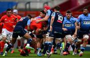 28 May 2021; CJ Stander of Munster is tackled by Cardiff Blues players, from left, Ben Thomas, Tomos Williams, and James Botham during the Guinness PRO14 Rainbow Cup match between Munster and Cardiff Blues at Thomond Park in Limerick. Photo by Piaras Ó Mídheach/Sportsfile