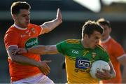29 May 2021; Peadar Mogan of Donegal is tackled by Niall Grimley of Armagh during the Allianz Football League Division 1 North Round 3 match between Armagh and Donegal at the Athletic Grounds in Armagh. Photo by Piaras Ó Mídheach/Sportsfile