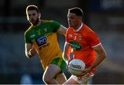 29 May 2021; Connaire Mackin of Armagh in action against Eoghan Bán Gallagher of Donegal during the Allianz Football League Division 1 North Round 3 match between Armagh and Donegal at the Athletic Grounds in Armagh. Photo by Piaras Ó Mídheach/Sportsfile