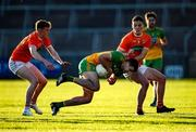 29 May 2021; Caolan McGonagle of Donegal in action against Jarly Óg Burns, right, and Conor Turbitt of Armagh during the Allianz Football League Division 1 North Round 3 match between Armagh and Donegal at the Athletic Grounds in Armagh. Photo by Piaras Ó Mídheach/Sportsfile