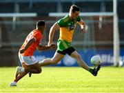 29 May 2021; Hugh McFadden of Donegal in action against Jemar Hall of Armagh during the Allianz Football League Division 1 North Round 3 match between Armagh and Donegal at the Athletic Grounds in Armagh. Photo by Piaras Ó Mídheach/Sportsfile
