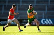 29 May 2021; Hugh McFadden of Donegal in action against Oisín O'Neill of Armagh during the Allianz Football League Division 1 North Round 3 match between Armagh and Donegal at the Athletic Grounds in Armagh. Photo by Piaras Ó Mídheach/Sportsfile
