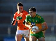 29 May 2021; Caolan McGonagle of Donegal in action against Aaron McKay of Armagh during the Allianz Football League Division 1 North Round 3 match between Armagh and Donegal at the Athletic Grounds in Armagh. Photo by Piaras Ó Mídheach/Sportsfile