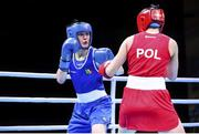 4 June 2021; Kellie Harrington of Ireland, left, and Aneta Rygielska of Poland in their lightweight 60kg bout on day one of the Road to Tokyo European Boxing Olympic qualifying event at Le Grand Dome in Paris, France. Photo by Sportsfile