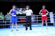 4 June 2021; Kellie Harrington of Ireland, left, celebrates victory over Aneta Rygielska of Poland in their lightweight 60kg bout on day one of the Road to Tokyo European Boxing Olympic qualifying event at Le Grand Dome in Paris, France. Photo by Sportsfile