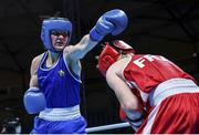 5 June 2021; Kellie Harrington of Ireland, left, and Maïva Hamadouche of France during their lightweight 60kg quarter-final bout on day two of the Road to Tokyo European Boxing Olympic qualifying event at Le Grand Dome in Paris, France. Photo by Sportsfile