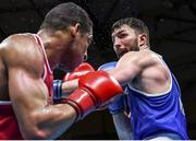 5 June 2021; Kirill Afanasev of Ireland, right, and Emmanuel Reyes of Spain in their heavyweight 91kg round of 16 bout on day two of the Road to Tokyo European Boxing Olympic qualifying event at Le Grand Dome in Paris, France. Photo by Sportsfile