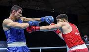 5 June 2021; Gytis Lisinskas of Ireland, right, and Petar Belberov of Bulgaria during their super-heavyweight +91kg round of 16 bout on day two of the Road to Tokyo European Boxing Olympic qualifying event at Le Grand Dome in Paris, France. Photo by Sportsfile