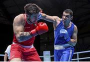 5 June 2021; Gytis Lisinskas of Ireland, left, and Petar Belberov of Bulgaria during their super-heavyweight +91kg round of 16 bout on day two of the Road to Tokyo European Boxing Olympic qualifying event at Le Grand Dome in Paris, France. Photo by Sportsfile