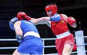 5 June 2021; Aoife O'Rourke of Ireland, right, and Elzbieta Wójcik of Poland during their middleweight 75kg quarter-final bout day two of the Road to Tokyo European Boxing Olympic qualifying event at Le Grand Dome in Paris, France. Photo by Sportsfile