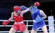 5 June 2021; Aoife O'Rourke of Ireland, left, and Elzbieta Wójcik of Poland during their middleweight 75kg quarter-final bout day two of the Road to Tokyo European Boxing Olympic qualifying event at Le Grand Dome in Paris, France. Photo by Sportsfile