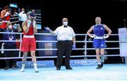5 June 2021; Aoife O'Rourke of Ireland, left, is declared the winner over Elzbieta Wójcik of Poland after their middleweight 75kg quarter-final bout on day two of the Road to Tokyo European Boxing Olympic qualifying event at Le Grand Dome in Paris, France. Photo by Sportsfile