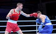 5 June 2021; Brendan Irvine of Ireland, left, and Gabriel Escobar of Spain during their flyweight 52kg quarter-final bout on day two of the Road to Tokyo European Boxing Olympic qualifying event at Le Grand Dome in Paris, France. Photo by Sportsfile
