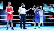 5 June 2021; Gabriel Escobar of Spain, right, is declared the winner over Brendan Irvine of Ireland during their flyweight 52kg quarter-final bout on day two of the Road to Tokyo European Boxing Olympic qualifying event at Le Grand Dome in Paris, France. Photo by Sportsfile