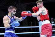 5 June 2021; Brendan Irvine of Ireland, right, and Gabriel Escobar of Spain during their flyweight 52kg quarter-final bout on day two of the Road to Tokyo European Boxing Olympic qualifying event at Le Grand Dome in Paris, France. Photo by Sportsfile