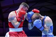 5 June 2021; Emmet Brennan of Ireland, left, and Luka Plantic of Croatia during their light heavyweight 81kg quarter-final bout on day two of the Road to Tokyo European Boxing Olympic qualifying event at Le Grand Dome in Paris, France. Photo by Sportsfile