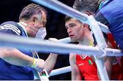 5 June 2021; Emmet Brennan of Ireland with coach Zaur Antia during his light heavyweight 81kg quarter-final bout against Luka Plantic of Croatia on day two of the Road to Tokyo European Boxing Olympic qualifying event at Le Grand Dome in Paris, France. Photo by Sportsfile
