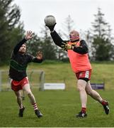 10 June 2021; Seamus McMahon in action against Declan Moane at the GAA for Dads & Lads Launch at St. Patricks GFC in Donagh, Fermanagh. Photo by David Fitzgerald/Sportsfile