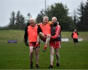 10 June 2021; Paulinus Curran is carried off the field after sustaining an injury by Seamus McMahon, left, and Ciaran McMahon at the GAA for Dads & Lads Launch at St. Patricks GFC in Donagh, Fermanagh. Photo by David Fitzgerald/Sportsfile