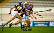 6 June 2021; Fiachra Fennell of Laois is tackled by Joey Holden, behind, and Huw Lawlor of Kilkenny during the Allianz Hurling League Division 1 Group B Round 4 match between Kilkenny and Laois at UPMC Nowlan Park in Kilkenny. Photo by Eóin Noonan/Sportsfile