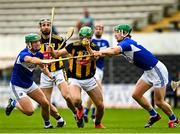6 June 2021; Tommy Walsh of Kilkenny is tackled by Eoin Gaughan, left, and Ross King of Laois during the Allianz Hurling League Division 1 Group B Round 4 match between Kilkenny and Laois at UPMC Nowlan Park in Kilkenny. Photo by Eóin Noonan/Sportsfile