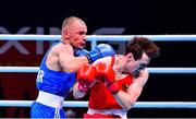 6 June 2021; Aidan Walsh of Ireland, right, and Yevhenii Barabanov of Ukraine in their welterweight 69kg quarter-final bout on day three of the Road to Tokyo European Boxing Olympic qualifying event at Le Grand Dome in Paris, France. Photo by Baptiste Fernandez/Sportsfile