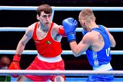 6 June 2021; Aidan Walsh of Ireland, left, and Yevhenii Barabanov of Ukraine in their welterweight 69kg quarter-final bout on day three of the Road to Tokyo European Boxing Olympic qualifying event at Le Grand Dome in Paris, France. Photo by Baptiste Fernandez/Sportsfile