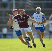 6 June 2021; Conor Whelan of Galway gets away from Calum Lyons, left, and Neil Montgomery of Waterford during the Allianz Hurling League Division 1 Group A Round 4 match between Galway and Waterford at Pearse Stadium in Galway. Photo by Ramsey Cardy/Sportsfile