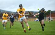 5 June 2021; Ciaran Clarke of Antrim in action against Connal Flood of Wexford during the Allianz Hurling League Division 1 Group B Round 4 match between Antrim and Wexford at Corrigan Park in Belfast. Photo by David Fitzgerald/Sportsfile
