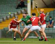5 June 2021; Conor Boylan of Limerick is tackled by Mark Coleman, left, Robert Downey, 7, and Niall O'Leary of Cork during the Allianz Hurling League Division 1 Group A Round 4 match between Limerick and Cork at LIT Gaelic Grounds in Limerick. Photo by Ray McManus/Sportsfile