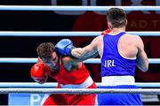 7 June 2021; Liridon Nuha of Sweden, left, and Emmet Brennan of Ireland in their light heavyweight 81kg Box Off for Olympic Place bout on day four of the Road to Tokyo European Boxing Olympic qualifying event at Le Grand Dome in Paris, France. Photo by Baptiste Fernandez/Sportsfile