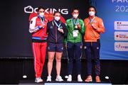 8 June 2021; Silver medalist Zenfira Magomedalieva of Russia, left, gold medalist Lauren Price of Great Britain, and bronze medalists Aoife O'Rourke of Ireland and Nouchka Fontijn of Netherland after the middleweight 75kg final on day five of the Road to Tokyo European Boxing Olympic qualifying event at Le Grand Dome in Paris, France. Photo by Anthony Dibon/Sportsfile
