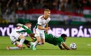 8 June 2021; Chiedozie Ogbene of Republic of Ireland in action against András Schafer and Janos Hahn, left, of Hungary during the international friendly match between Hungary and Republic of Ireland at Szusza Ferenc Stadion in Budapest, Hungary. Photo by Alex Nicodim/Sportsfile