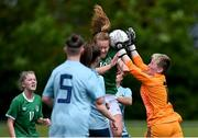 9 June 2021; Muireann Devaney of Republic of Ireland contests possession against Northern Ireland goalkeeper Rachel Norney during the Women's U19 International Friendly between Republic of Ireland and Northern Ireland at AUL Complex in Dublin. Photo by Piaras Ó Mídheach/Sportsfile