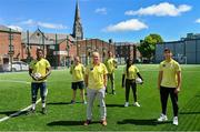 """10 June 2021; Ambassadors Brian Kerr and Michael Darragh MacAuley with, from left, Mehari Kahasay, Michelle Kane, Recreation worker, Dublin City Council, Mariama Kamari and Tareq Altourk pictured at the launch of the Football for Unity Festival which will take place at venues across the north east inner city of Dublin from Monday 14th of June to Friday 16th of July. The Football for Unity Festival aims to foster the social inclusion of third-country nationals sustainably through active participation in football-based initiatives. For more information visit - www.footballforunity.ie"""".  Photo by Brendan Moran/Sportsfile"""