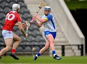 9 May 2021; Stephen Bennett of Waterford scores his side's first goal under pressure from James O'Flynn of Cork during the Allianz Hurling League Division 1 Group A Round 1 match between Cork and Waterford at Páirc Ui Chaoimh in Cork. Photo by Piaras Ó Mídheach/Sportsfile