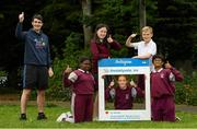 11 June 2021; Minister of State for Sport and the Gaeltacht Jack Chambers TD with 6th class pupils from his former school St. Brigid's National School, from left, Nero Arubayi, Phoebe Duncan, Aveen McDonnell, Jarlath O'Farrell and Sibbhant Raipal at the Daily Mile launch at St. Brigid's National School, Beechpark Lawn, Castleknock in Dublin.  Photo by Matt Browne/Sportsfile
