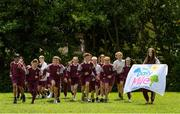 11 June 2021; Siena Lacey, right, of St. Brigid's National School holds the Daily Mile flag as her classmates run during the Daily Mile launch at St. Brigid's National School, Beechpark Lawn, Castleknock in Dublin.  Photo by Matt Browne/Sportsfile