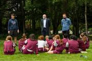 11 June 2021; Minister of State for Sport and the Gaeltacht Jack Chambers TD with 6th class pupils from his former school St. Brigid's National School with, from left, CEO Athletics Ireland Hamish Adams and class teacher Patrick Lowery at the Daily Mile launch at St. Brigid's National School, Beechpark Lawn, Castleknock in Dublin.  Photo by Matt Browne/Sportsfile