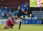 11 June 2021; Ryan Baird of Leinster is tackled by Brok Harris of Dragons during the Guinness PRO14 match between Leinster and Dragons at RDS Arena in Dublin. The game is one of the first of a number of pilot sports events over the coming weeks which are implementing guidelines set out by the Irish government to allow for the safe return of spectators to sporting events. Photo by Brendan Moran/Sportsfile