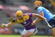 12 June 2021; Kevin Foley of Wexford in action against Ronan Hayes of Dublin during the Allianz Hurling League Division 1 Round 5 match between Wexford and Dublin at Chadwicks Wexford Park in Wexford. Photo by Matt Browne/Sportsfile
