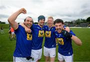 12 June 2021; Wicklow players, from left, Arran Murphy, Paul Cunningham, Mark Kenny and Oisin Manning celebrate following the Allianz Football League Division 3 Relegation play-off match between Cavan and Wicklow at Páirc Tailteann in Navan, Meath. Photo by Stephen McCarthy/Sportsfile