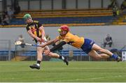 12 June 2021; Martin Keoghan of Kilkenny shoots to score his side's first goal despite the attention of John Conlon of Clare during the Allianz Hurling League Division 1 Group B Round 5 match between Clare and Kilkenny at Cusack Park in Ennis, Clare. Photo by Ramsey Cardy/Sportsfile