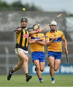 12 June 2021; Darragh Corcoran of Kilkenny in action against David Reidy, left, and Aidan McCarthy of Clare during the Allianz Hurling League Division 1 Group B Round 5 match between Clare and Kilkenny at Cusack Park in Ennis, Clare. Photo by Ramsey Cardy/Sportsfile